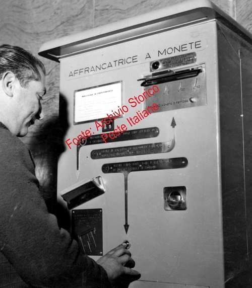 OMT - man using coin self-service machine